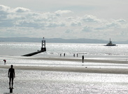 Ayton Cross departs the River Mersey passing Crosby Beach Iron Men Statues
