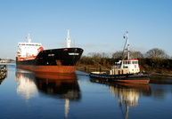 Euro Swan departs Eastham Locks assisted by tug MSC Victory
